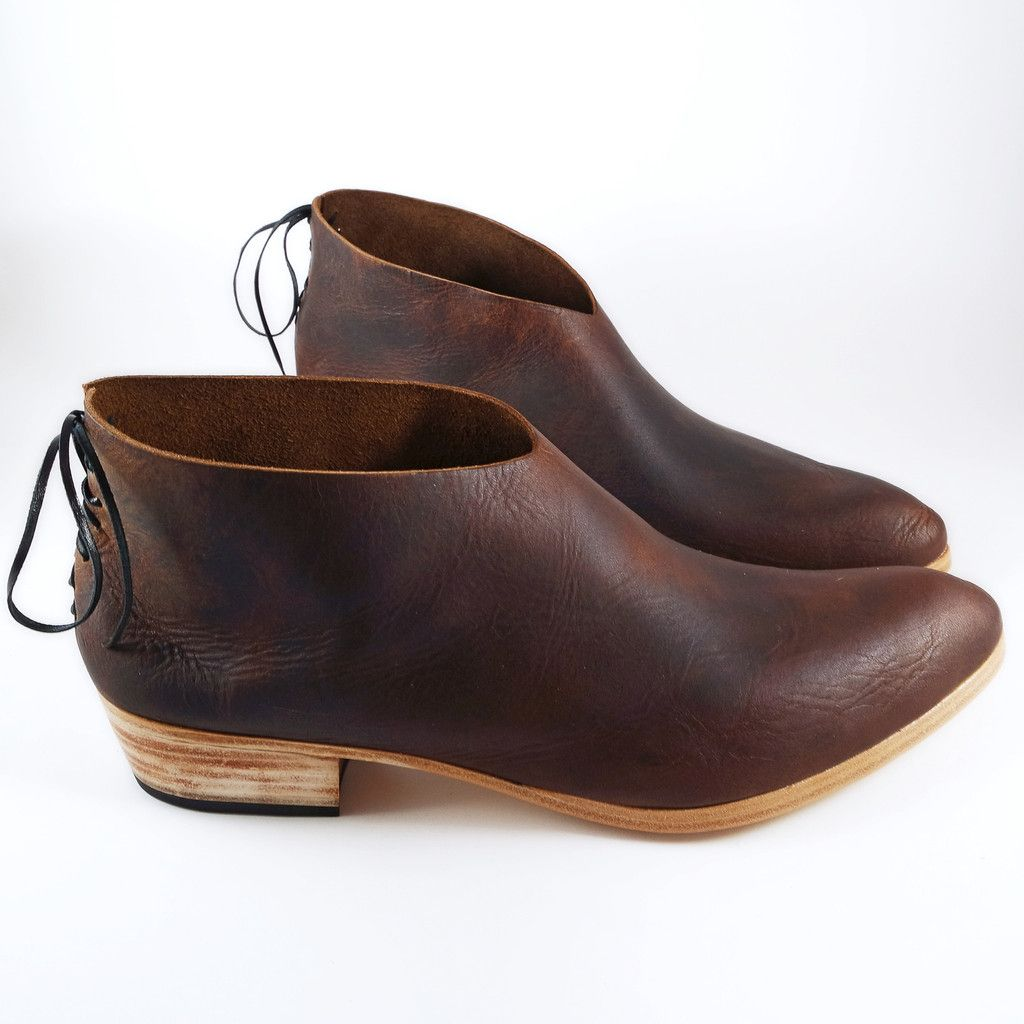 The classic Griffin in a beautiful antique brown leather from Italy is our go to shoe for an understated comfort. Don't let it's versatility fool you...it's backlaced accent gives this mens style clas