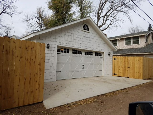 These Traditional Carriage Style Garage Doors Look Great On This Brand New Tuff Shed Garage The All White C Shed Carriage Style Garage Doors Shed Construction