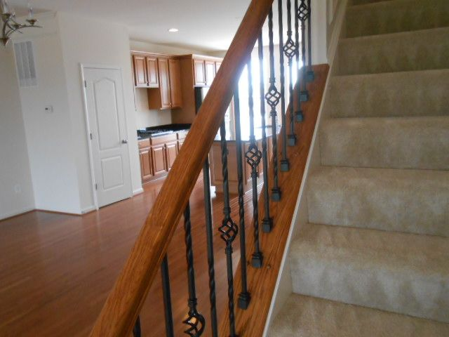 Fully Carpeted Stairs With Upgraded Iron Spindles