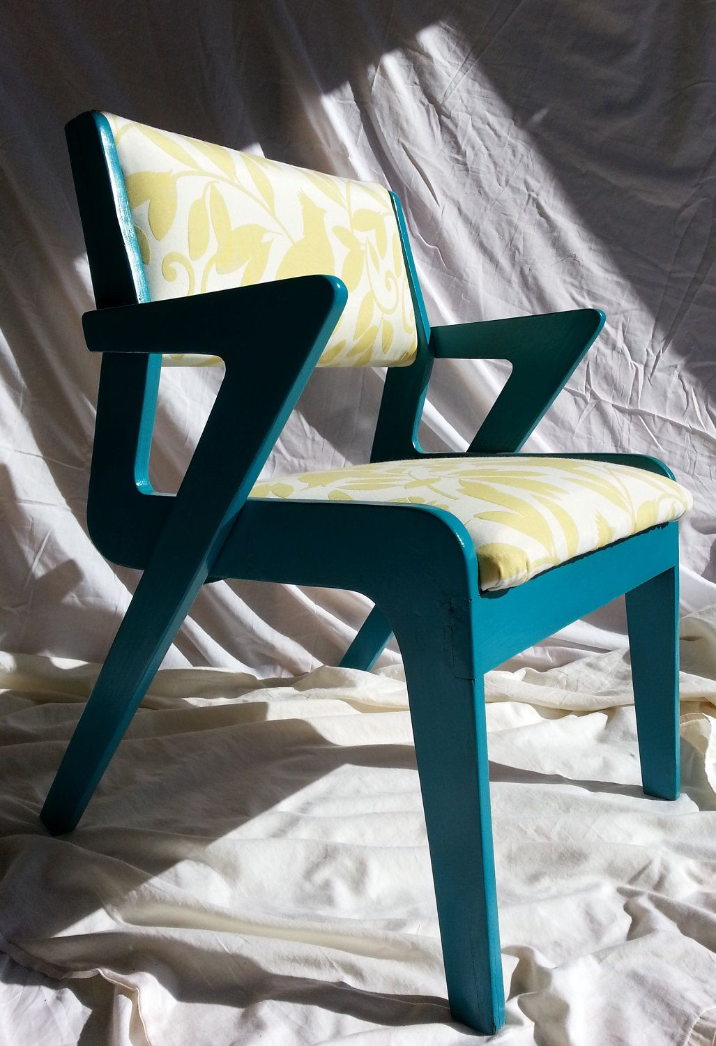 Vintage Refurbished Mid Century Modern Turquoise/Yellow Upholstered Chair. $200.00, via Etsy.