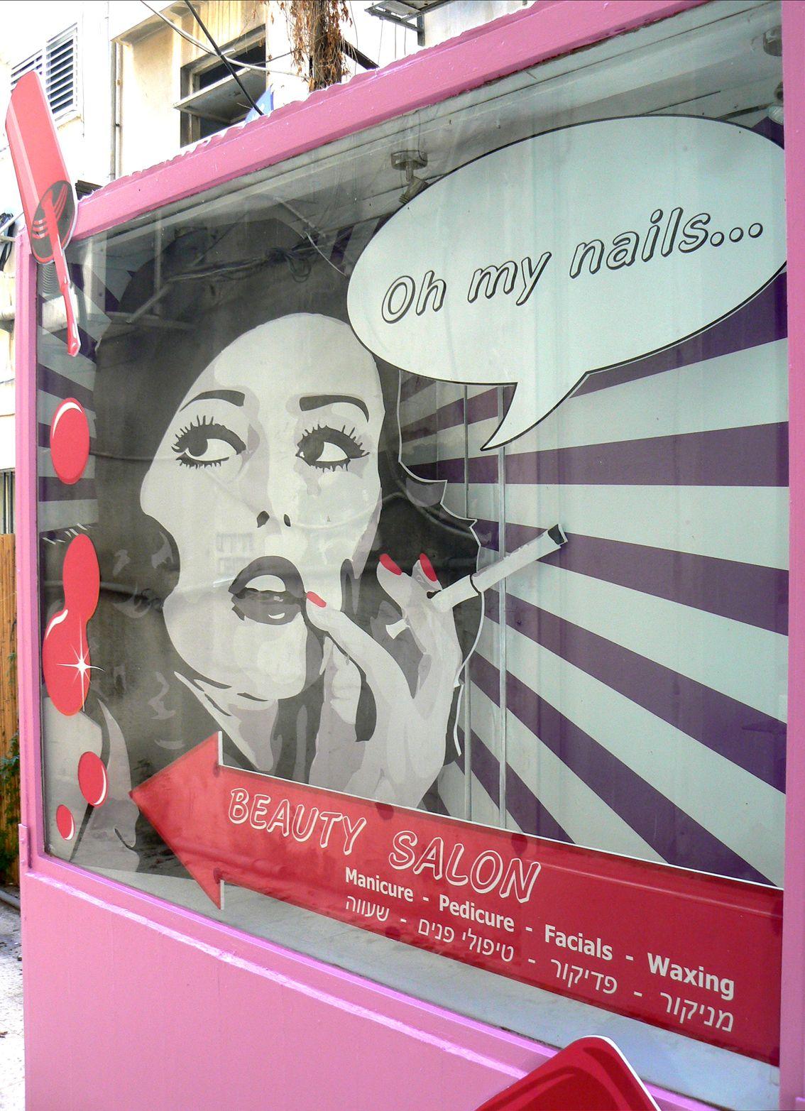 nail salon window display. a little retro but eye catching ...