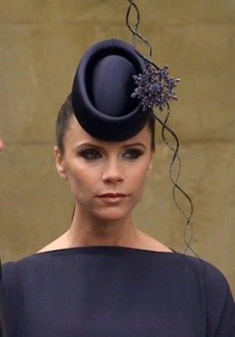 Victoria Beckham in a floral Philip Treacy fascinator for the Royal Wedding. ea25292f621b