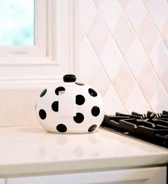 The offspring of our top-selling Happy Everything Black Dot Cookie Jar, the Mini Happy Everything Black Dot Cookie Jar is the perfect addition to the Happy Everything line. You will love the functionality and versatility of this new size - it's perfect for the kitchen counter, desk top or bathroom shelf.