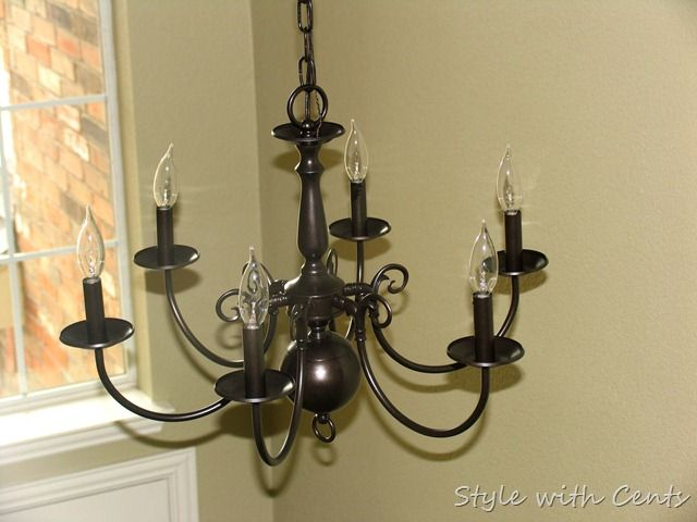 Rustoleum oil rubbed bronze spray paint on a builder grade diy update and reuse your old ugly brass chandelier use oil rubbed bronze spray paint from rustoleum to update your chandelier aloadofball Image collections