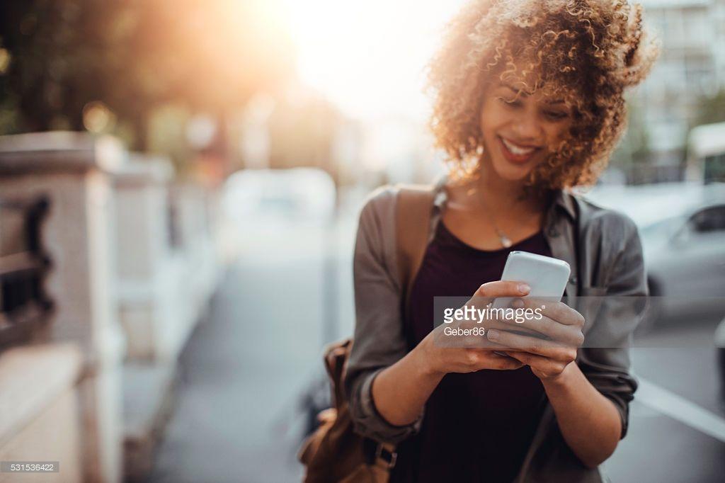 Stock Photo Photo of a woman using smart phone