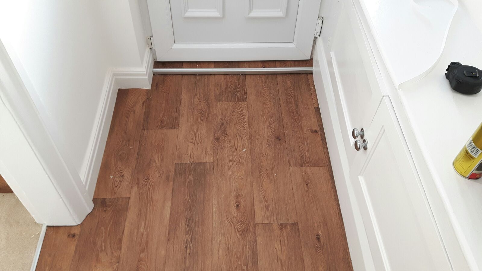 Laminate effect vinyl flooring fitted to a hallway in