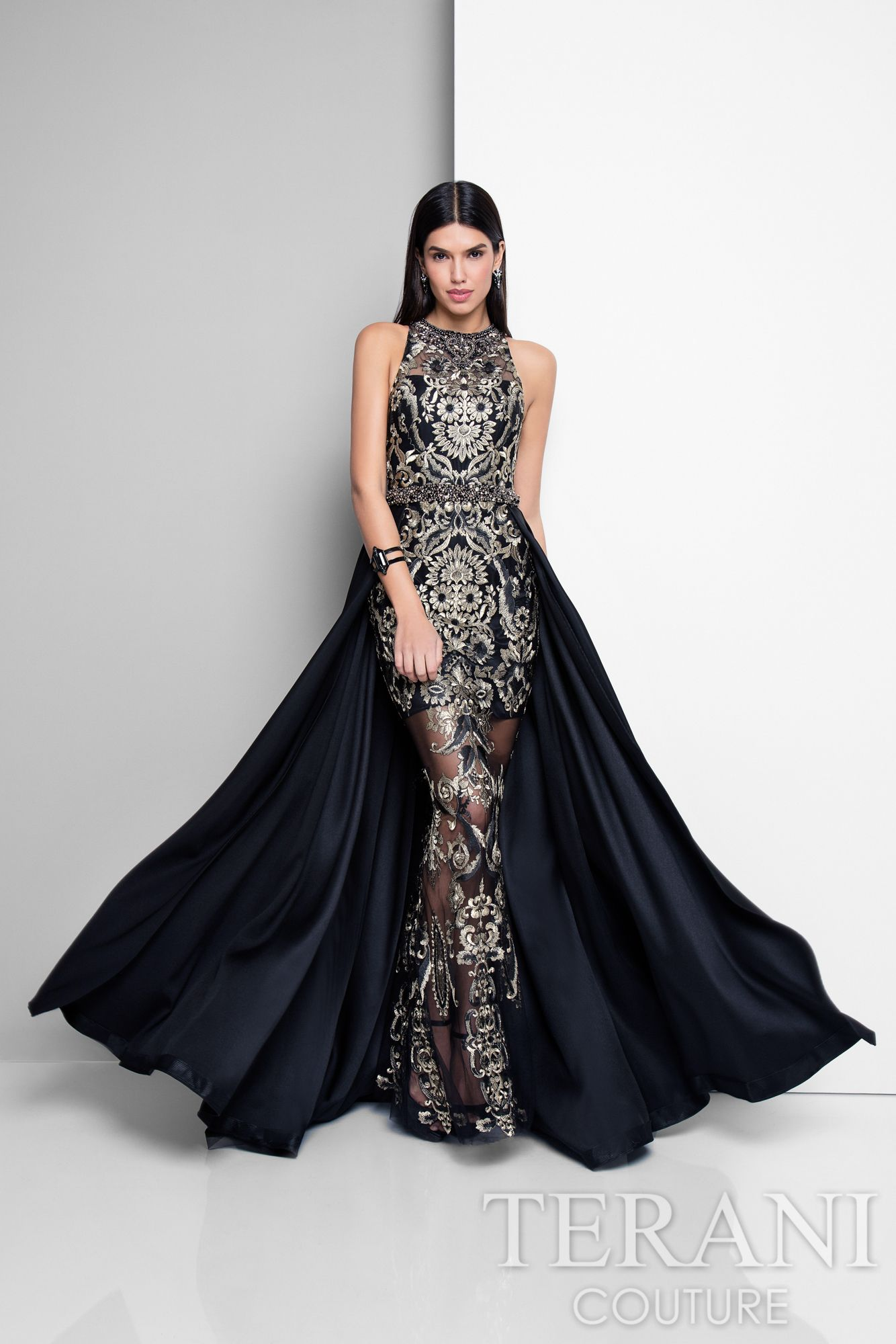 637004c0adaf Stunning black&gold two-tone metallic embroidery is artfully placed on this  halter column evening wear gown, complemented by a dramatic pleated skirt  ...