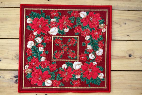 This is a festive Christmas panel that I spent a lot of time quilting around all the flowers. You can see that on the back. This would look lovely on your table during the holidays!  Measurements: 15.5x16.5  Machine wash in cold water and air dry in the dryer to avoid shrinkage. Ive signed and dated it on the back. Colors vary slightly from the original. It comes from a smoke free home.  INTERNATIONAL BUYERS: Please convo me so that I can get actual shipping costs.