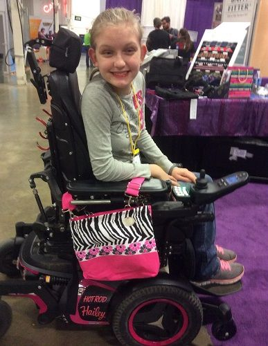 d92e38fbce8 The Pink Zebra matches her power chair perfectly... and judging by that  smile, it's safe to say she agrees!