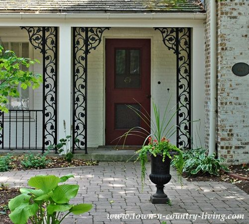 Easy Ways To Create Curb Appeal Live Creatively Inspired Wrought Iron Front Door Wrought Iron Porch Railings Porch Columns