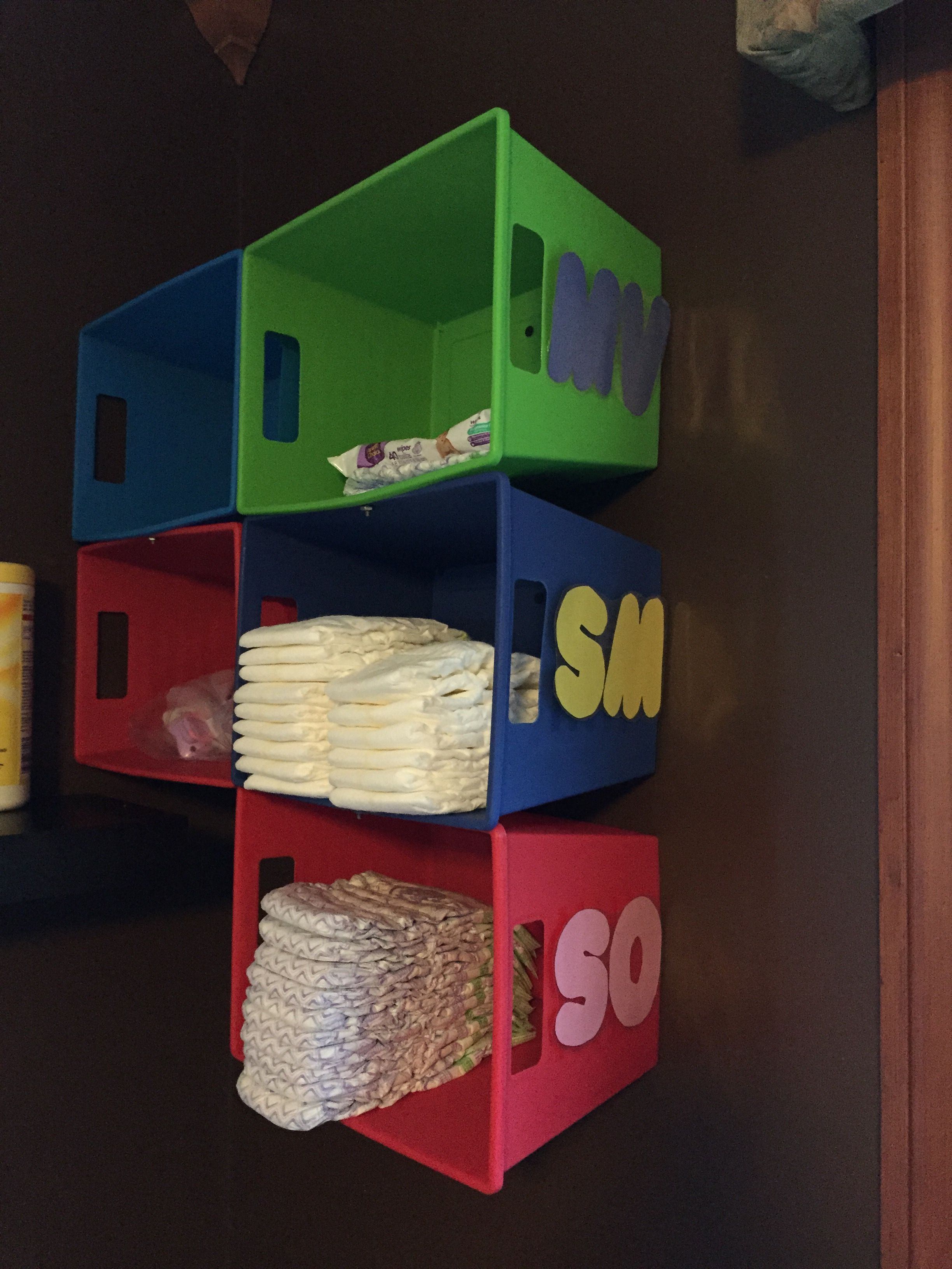 Inexpensive Diaper Cubbies. These Are Made From Colorful Bins From The Dollar Store. Each Day