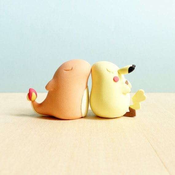 An Insanely Adorable Pair Of Charmander And Pikachu Wedding Cake Toppers