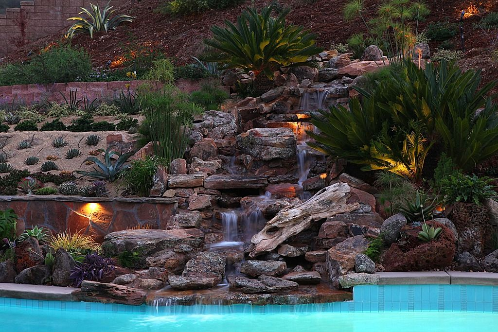 Rustic Swimming Pool - Love the waterfall and lighting options