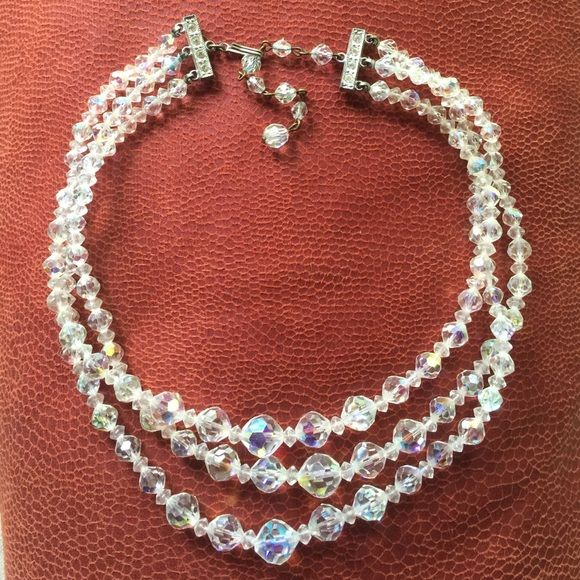 Triple Strand Crystal Necklace Triple strand clear crystal necklace. Has a rainbow effect. Very beautiful Jewelry Necklaces