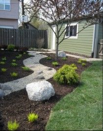 Rock Garden Like a River by Dig Right In Landscaping, Brookfield, IL