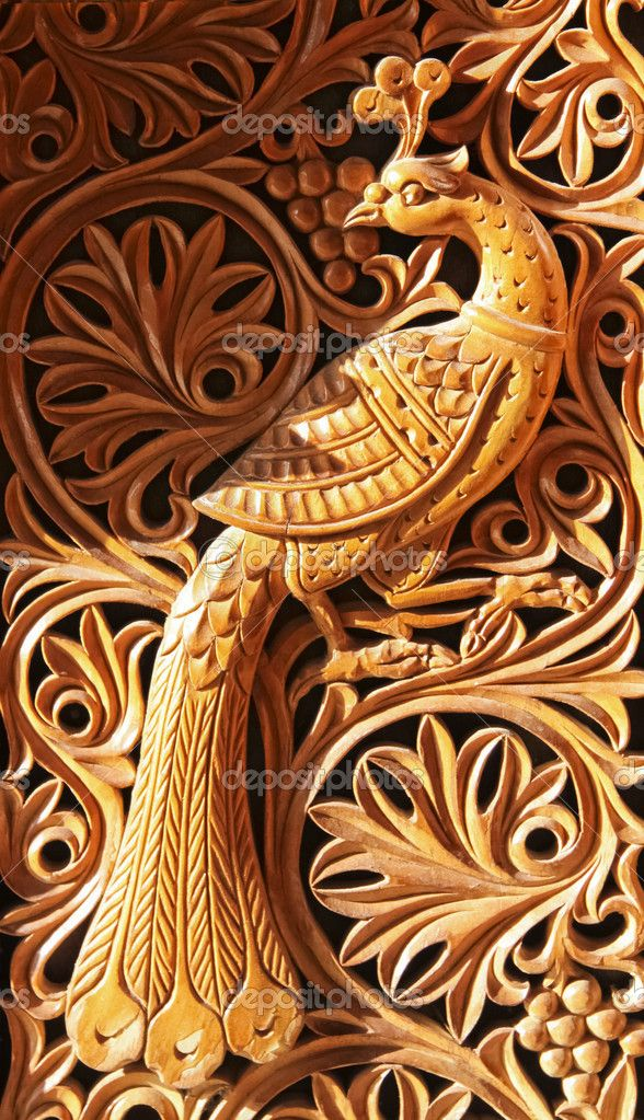 Phoenix wood carving — stock image birds and