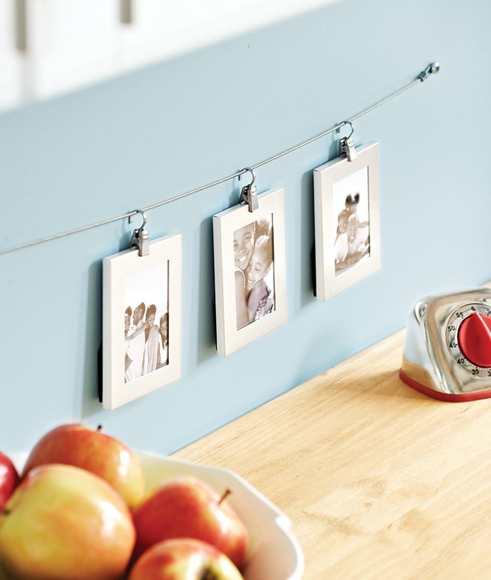 Purchased Clips Hang Small Photo Frames From A Wire