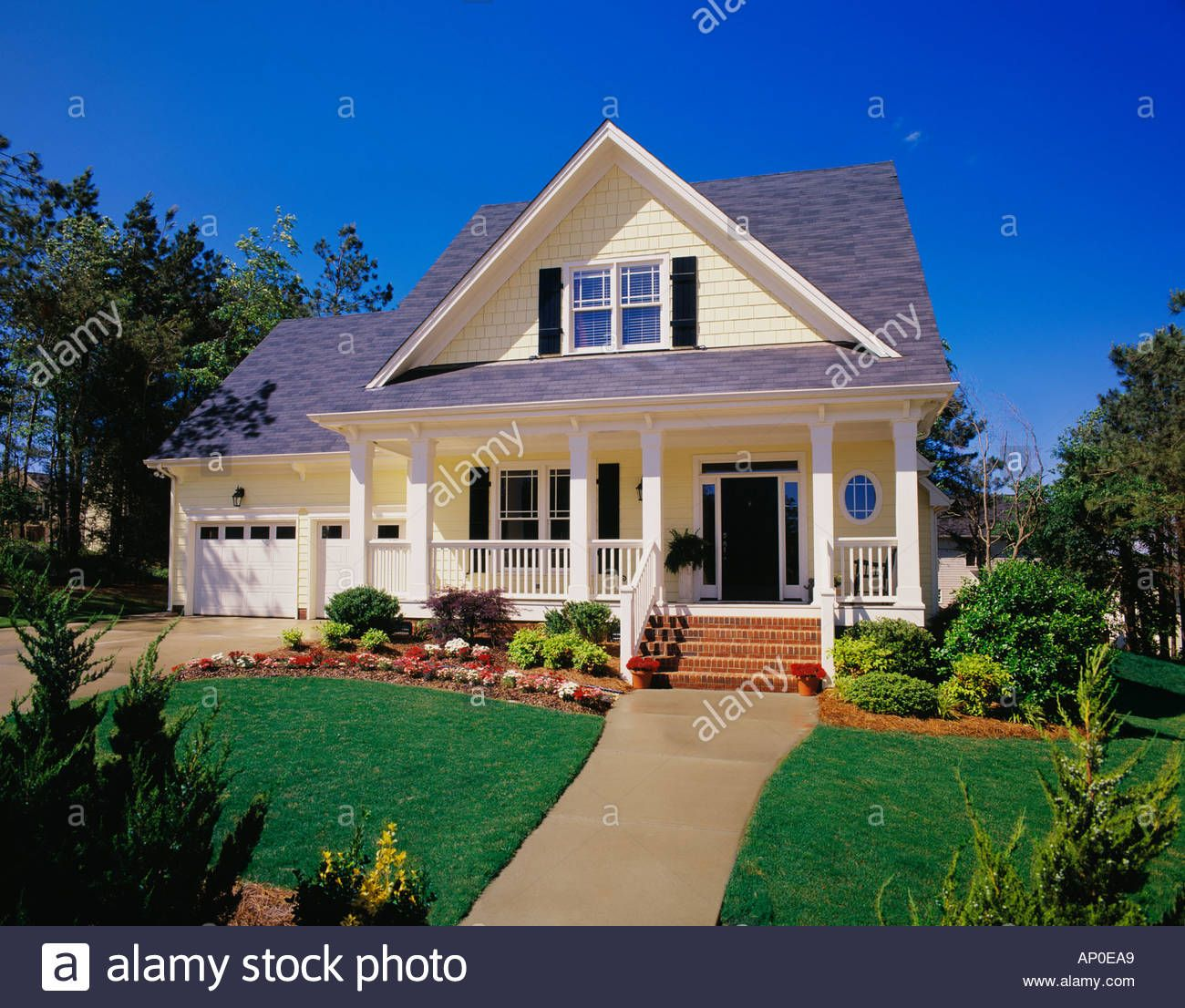 Small Two Story Yellow House With Black Shutters A Porch