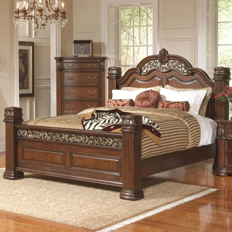 Bedroom. brown lacquer mahogany wood bed frame with carved