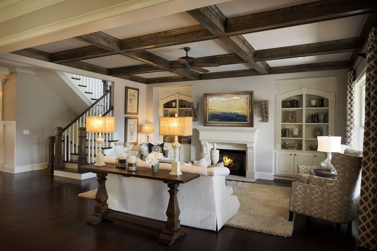 Rustic beams are a memorable design element in this great room. New homes in the Somerdale community built by Edward Andrews Homes in Cumming, GA.