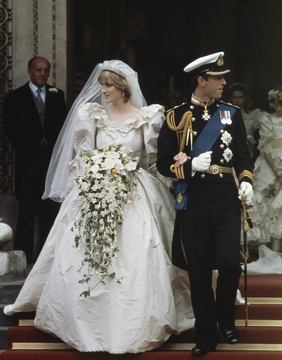 Princess diana marries prince charles wearing a david and for British royal wedding dresses