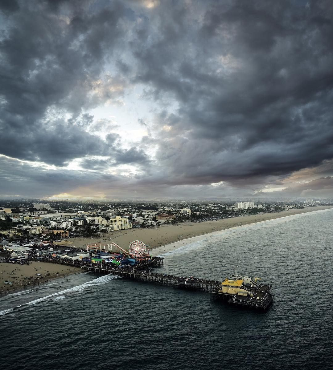 Originally the #SantaMonicaPier was anything but fun and carefree. It actually served the very practical purpose of carrying sewage out past the breakers back in 1909.  Shot by @cole_younger_ by highsnobiety
