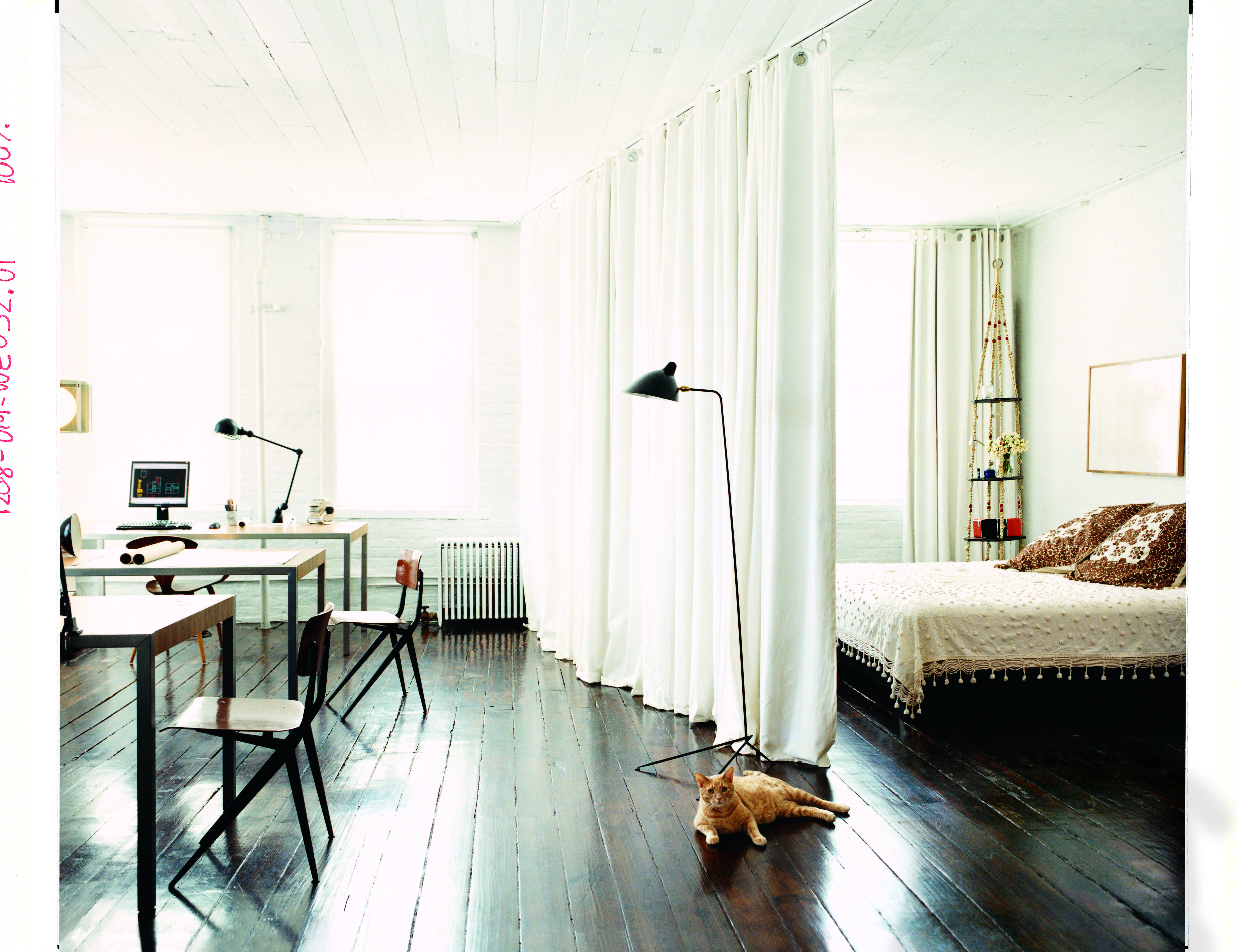 thick corduroy ikea curtains lined with blackout fabric and hung on ceiling tracks creates space in