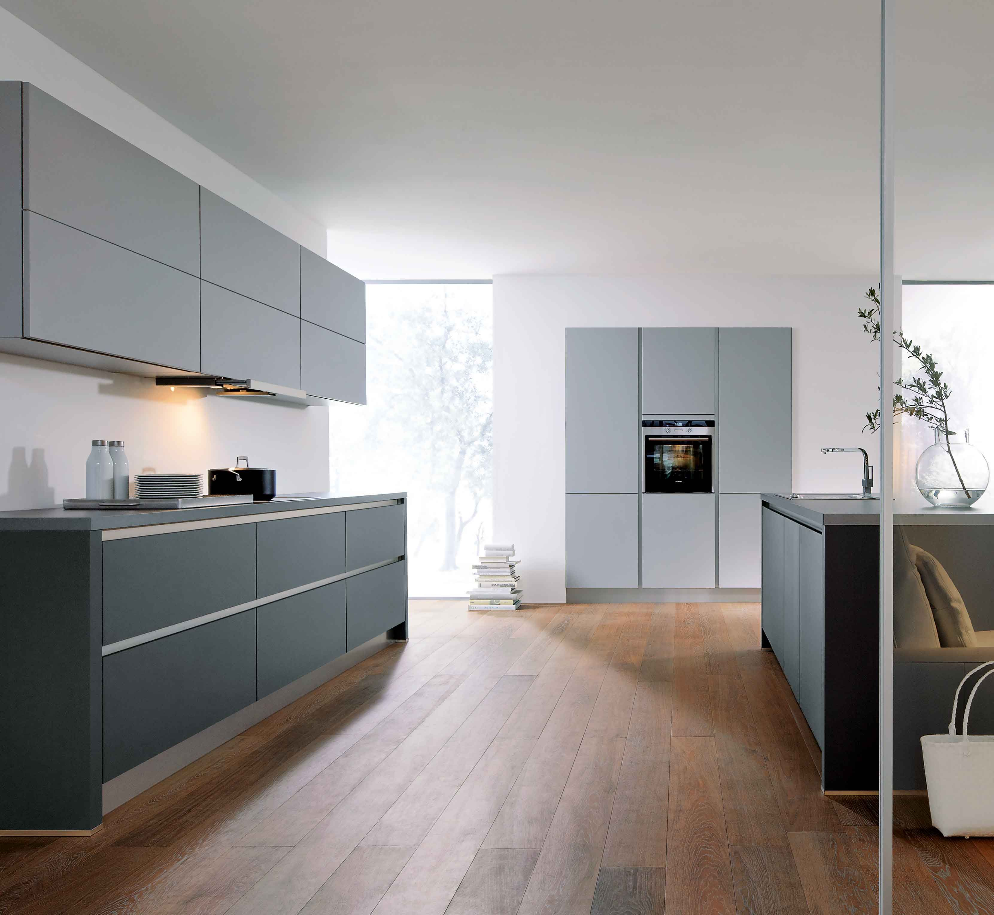 A lava black and stone grey kitchen. The grip ledges and plinth are ...