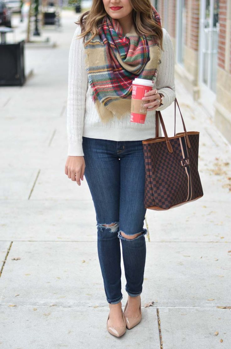 d072b0df51 chic winter outfit - cream sweater with plaid blanket scarf and distressed  jeans