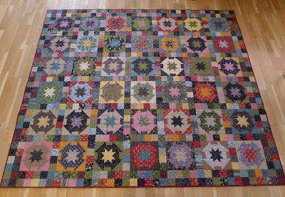 Litamora's Quilt & Design.  Love this scrappy Star quilt.