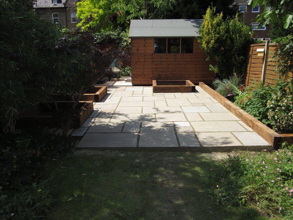 Indian Sandstone Garden Patio With Railway Sleeper Edging For Flower Beds Patio Garden Garden Paving Railway Sleepers