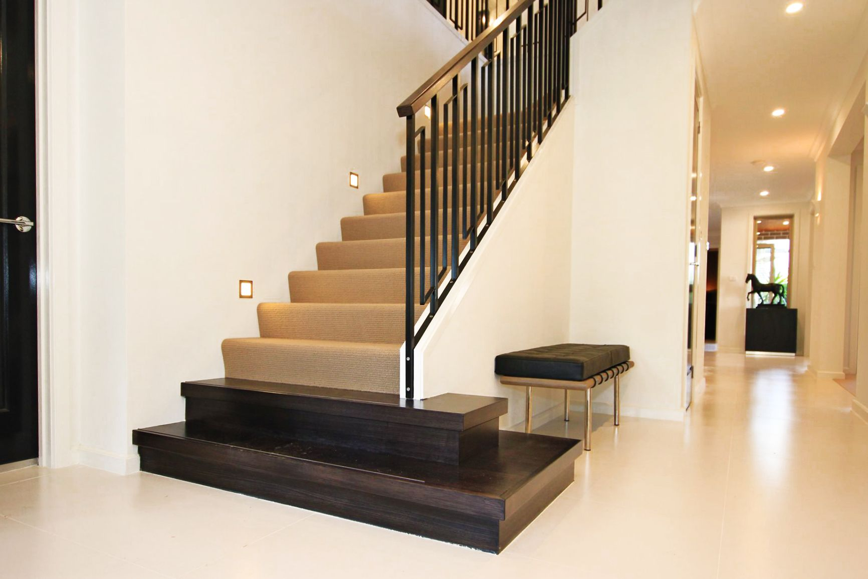 Carpeted Staircase With A Timber Feature Bullnose Wrought Iron Balusters With Timber Handrail Made By Genneral Timber Stair Carpet Staircase Timber Handrail