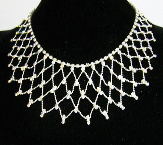 Vintage silver tone clear rhinestone dropper necklace with tennis style chain.