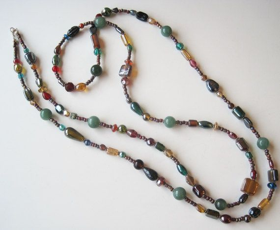 08e958b437ed ... 56-inch long necklace. Its made of multi-color glass beads in shades of  brown