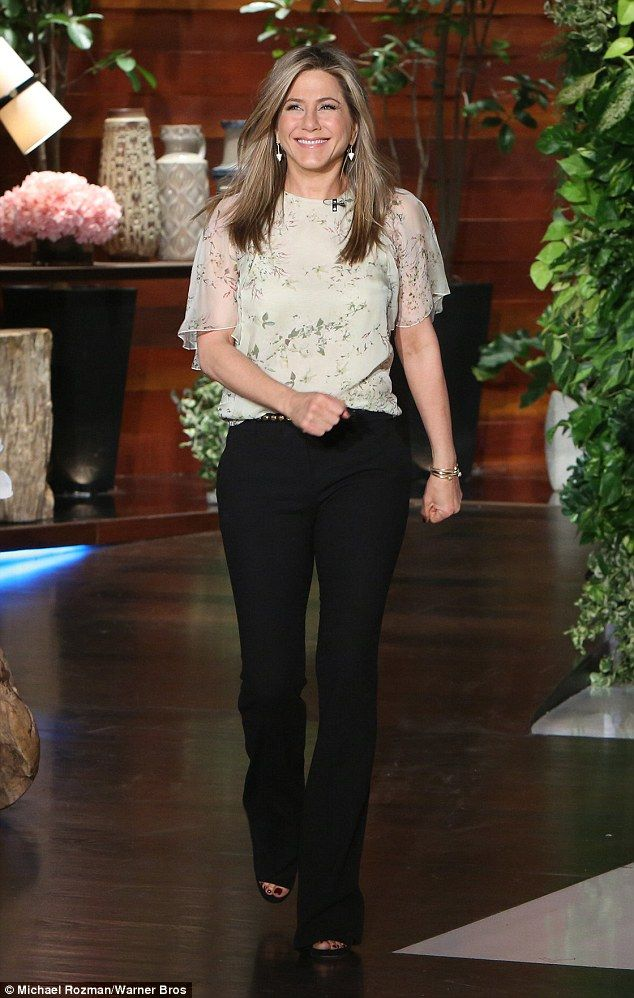 Happy: The 45-year-old star looked lovely in a patterned blouse and black trousers...