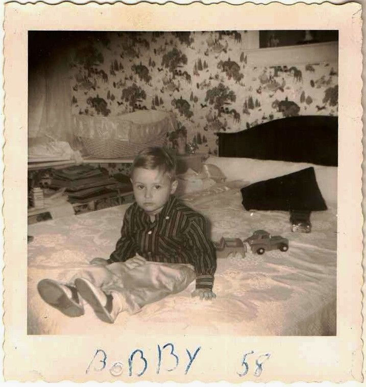 Old Vintage Antique Photograph Adorable Little Boy Sitting on Bed With Toys