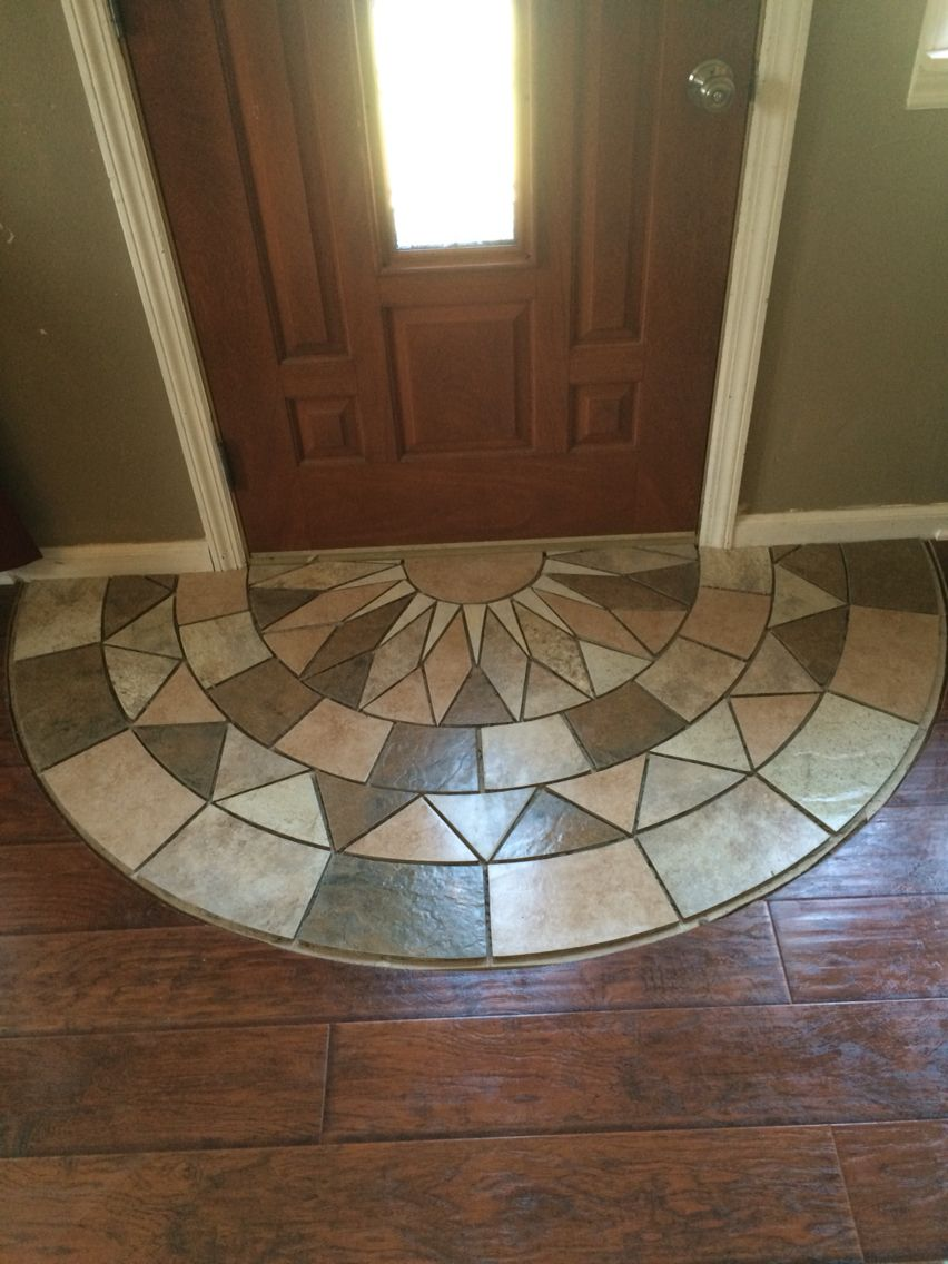 Tile doorway entry protecting the laminate from tracking the elements in haven
