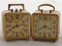 "Two small French DEP alarm clocks of the ""bijou"" type"