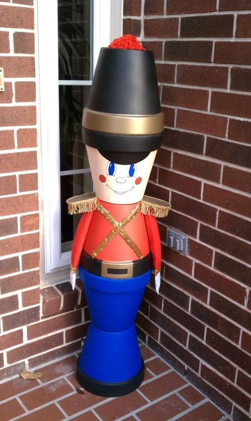 diy clay pot nutcracker 1 DIY Clay Pot Christmas Decorations That Add Charm To Your