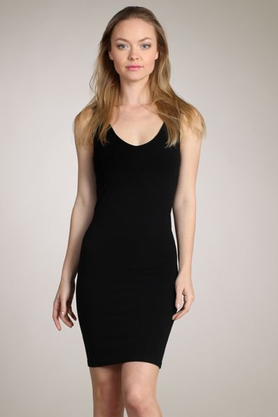 This sleeveless M-Rena scoop neck seamless layering tank dress is the ideal  base for layering while giving you a fitted and flattering silhouette b61a0662a