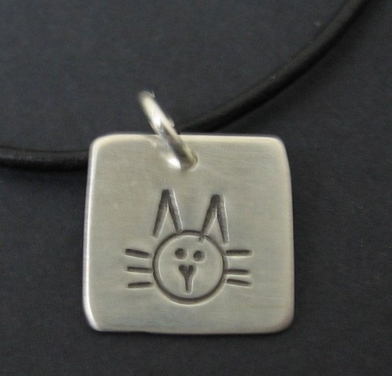 Hand-forged cat pendant with necklace