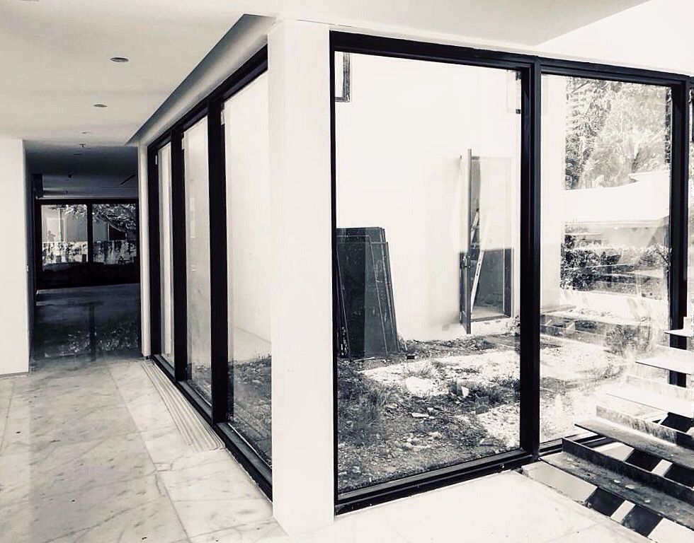Completed Project Of Impact Resistant Windows And Doors In Brickell Florida Hurricaneprotection Impactwin Windows And Doors Impact Windows New Construction
