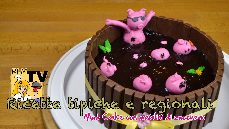 Mud cake al cioccolato con maialini di zucchero