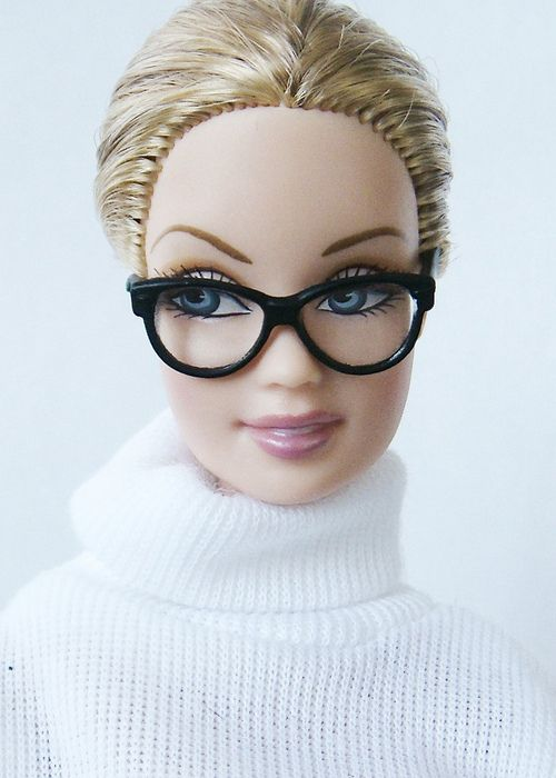 Barbie wearing white turtleneck and black glasses