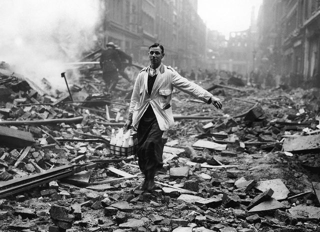 A milkman delivering milk in a London street. Photo by Fred Morley.