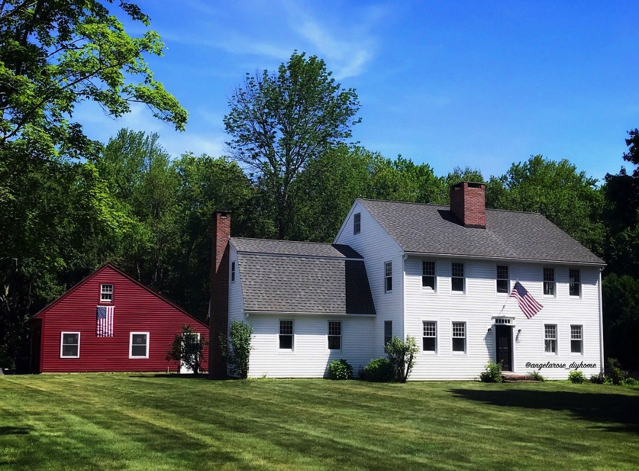 White Farmhouse Red Barn Traditional White Colonial With Flags