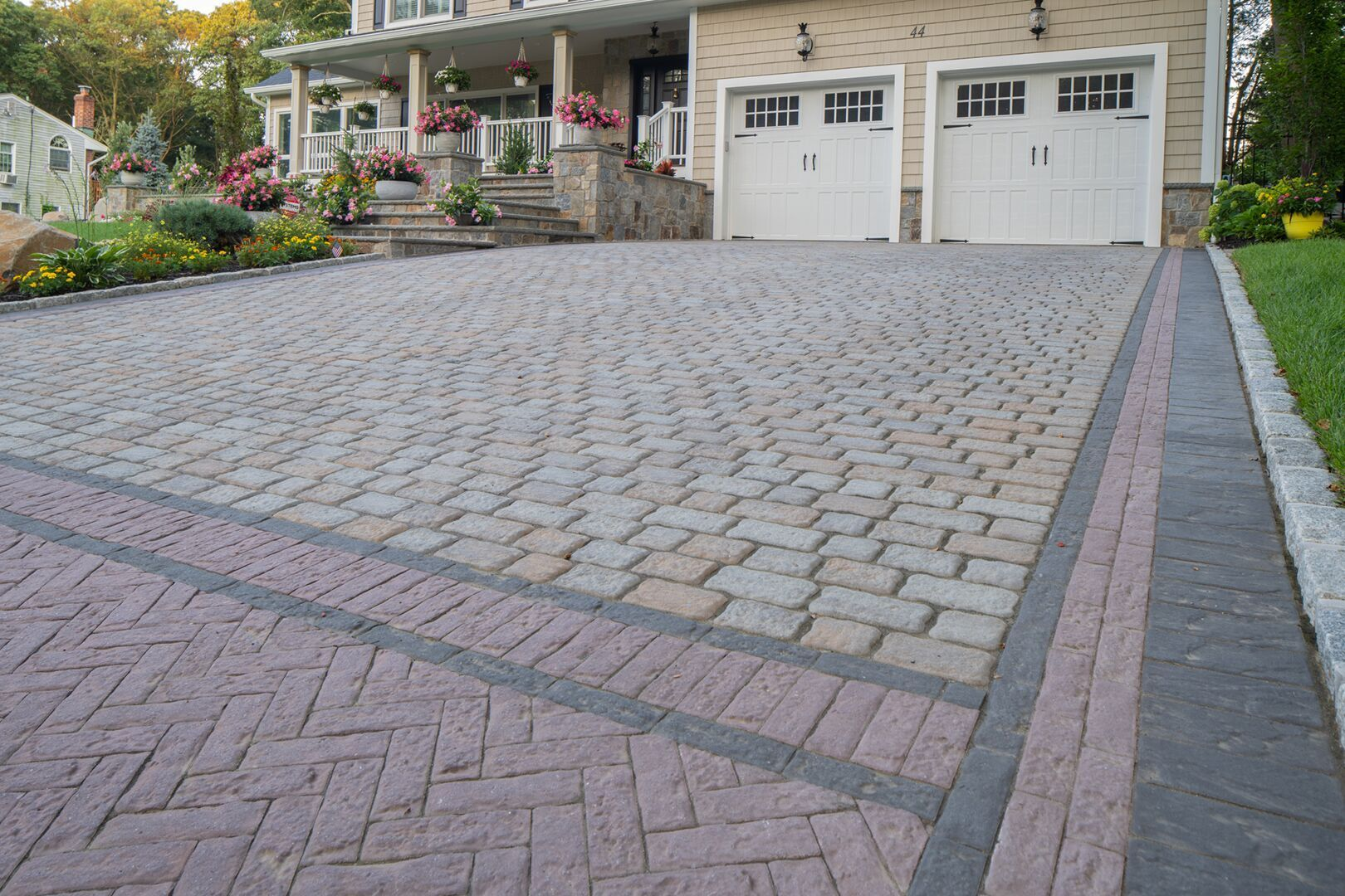 Boost your curb appeal with a variety of our pavers! Installation: Cardi Landscape  #driveway #outdoorliving #pavingstones #curbappeal