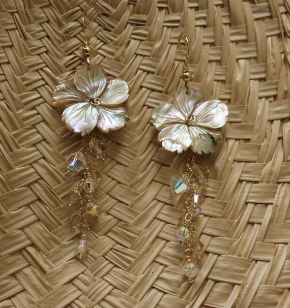 Delicate carved shell dangling plumeria earrings with wired wrapped crystals,  Delicate frangiapani earrings