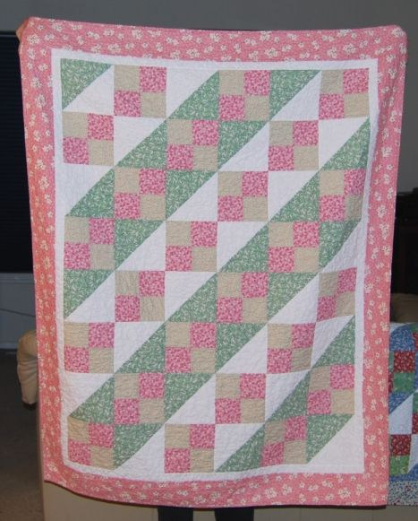 #quilt in pink and green 1930's reproduction fabrics.