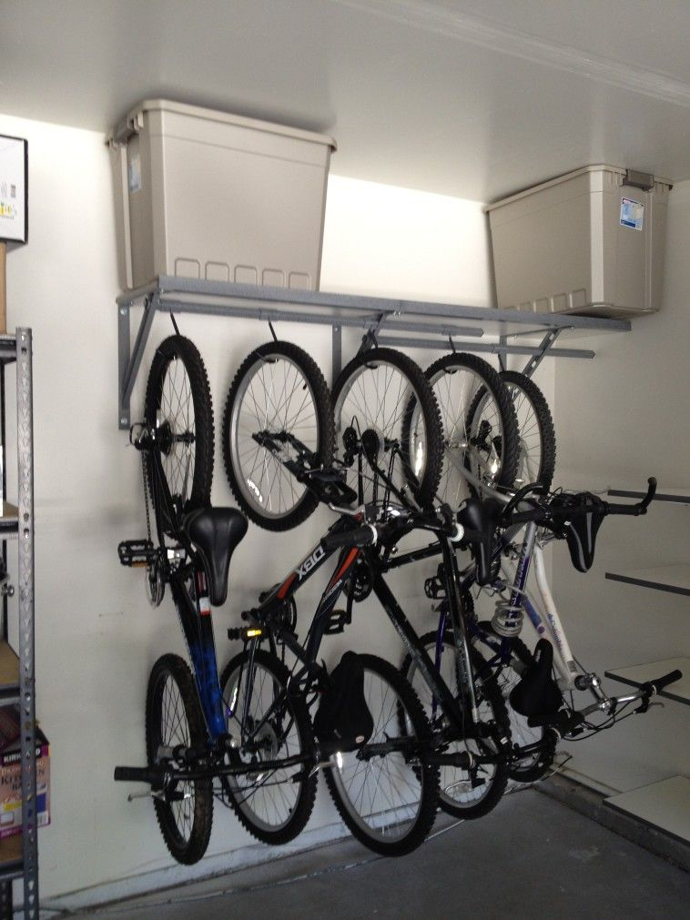 Vertical Hanging Garage Bike Storage With Wrought Iron Bracket